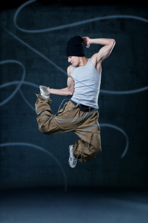 Young hip-hop dancer jumping photo
