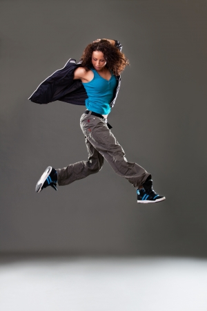 Young woman dancer jumping  photo