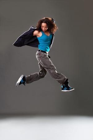 street dance: Young woman dancer jumping