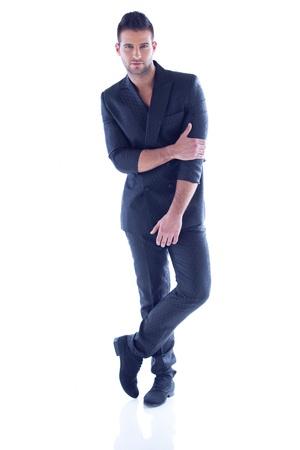 Handsome man standing in elegant clothing Standard-Bild