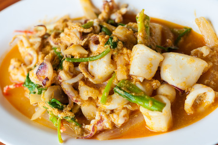 Squid crab in yellow curry photo