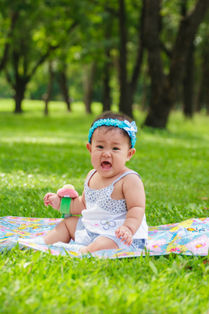 verry: Baby in The Graden Verry Sad and cry Stock Photo