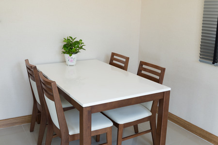 Wooden dining table for 4 people photo