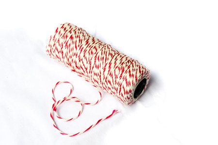 baker's: Red and white bakers twine spool on isolated background