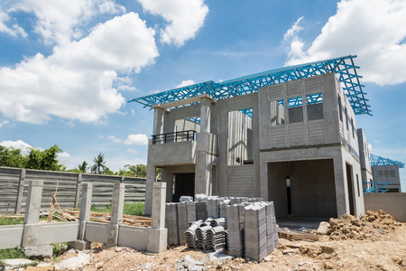 steelwork: New home under construction using steel frames against cloudy sky Stock Photo