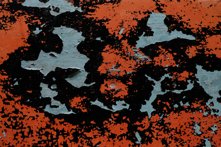 painted in orange and black wall peeling off photo