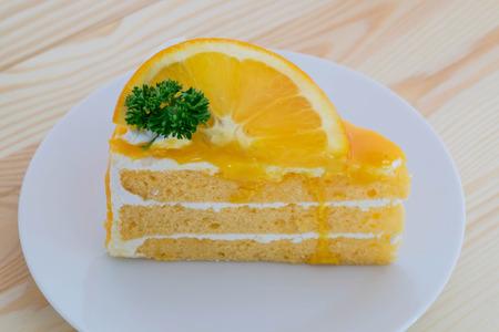 orange cake: orange cake with orange topping in wooden dish Stock Photo