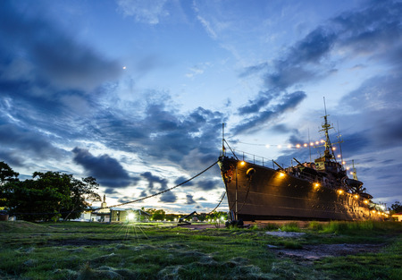 Former warships exhibited as museums on the back are suns that are going to the horizon. Stock Photo