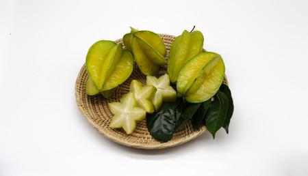 star fruit: star fruit on basket on white background Stock Photo
