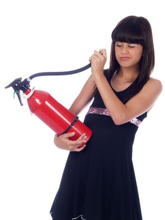 young girl looking in fire extinguisher photo