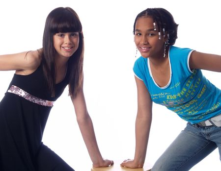 2 cute girls with different ethnic backgrounds Stock Photo