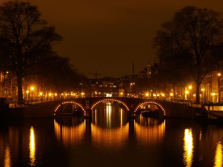 Canals of Amsterdam by night Stock Photo