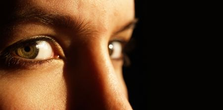 Low key image of a beautiful green eye