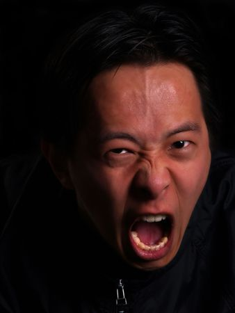 An angry Asian man screaming at you