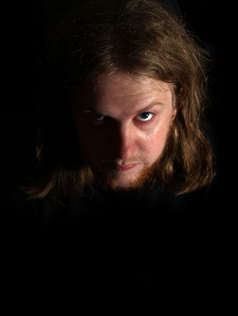 A scary man with bright blue eyes staring at you Stock Photo - 2831826