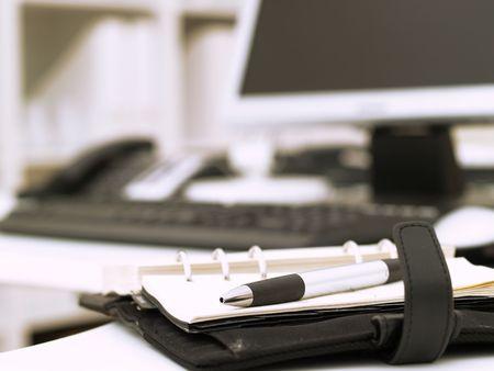 Pen on an open business agenda