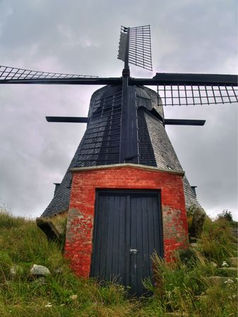 Old and red windmill located in the North of Denmark photo
