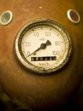Rusty speedometer on a vintage motorcycle
