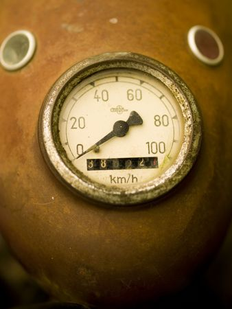 Rusty speedometer on a vintage motorcycle photo