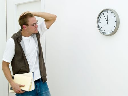 getting late: Young adult is getting late with his books in his hand Stock Photo