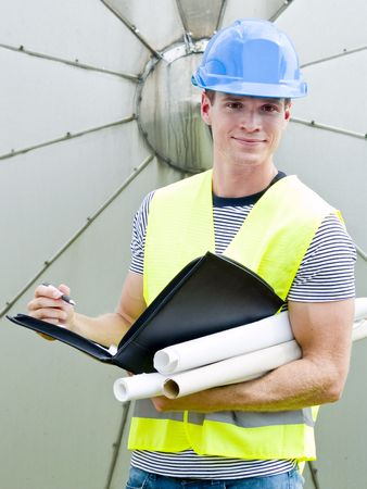 construction worker looking at the diagrams and blueprints photo