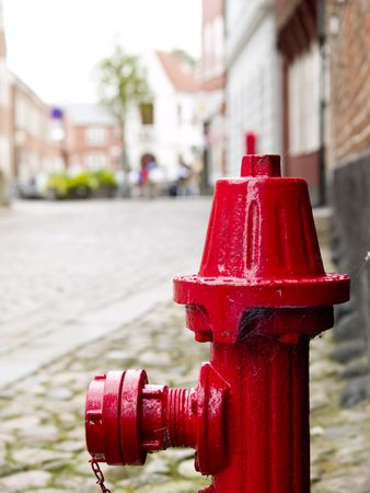 Red fire hydrant on the curbe in a small town photo