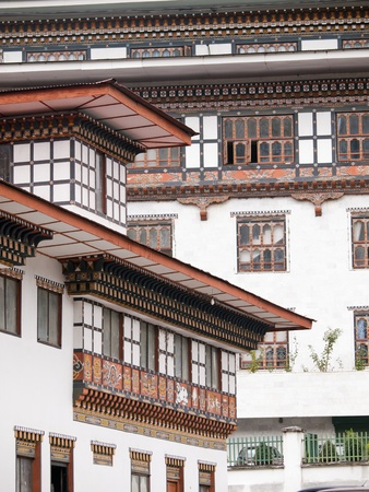 The traditional architecture of the Bhutanese houses as seen in Bhutans capitol Thimphu photo