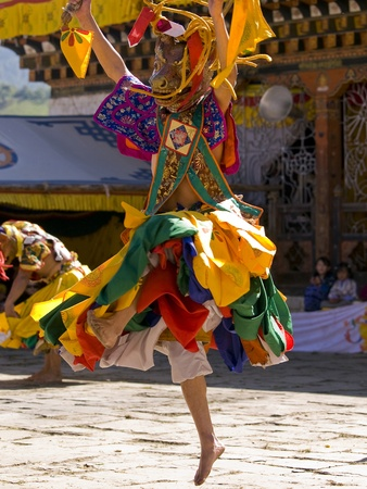 Masked man are dancing on a tsechus (Bhutanese fesival)