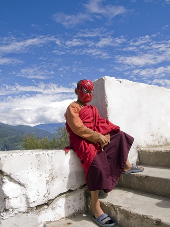 spiderman: THIMPU, BHUTAN - OCTOBER 20, 2010: Buddhist monk with spiderman mask on Oct. 20, 2010 in Thimpu. Bhutan is trying to preserve their traditions but the upcoming western culture is an increasing problem