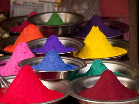 Colorful powders used for dyeing at a market in Orchha, India  Stock Photo