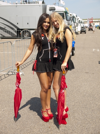 ZANDVOORT, NETHERLANDS - JULY 7: Two pitbabes are posing behind the pitlane in the paddock after the race of the Fia GT series during the RTL GP Masters in Zandvoort on July 7, 2013 in Zandvoort, Holland.