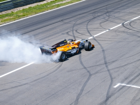 wheelspin: ZANDVOORT, NETHERLANDS - JULY 7  Tom Coronel burns some rubber in an AutoGP Formula car with a V8 Zytek motor during a demonstration at the RTL GP Masters in Zandvoort on July 7, 2013 in Zandvoort, Holland  Editorial
