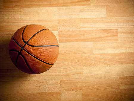 An official orange ball on a hardwood basketball court Reklamní fotografie