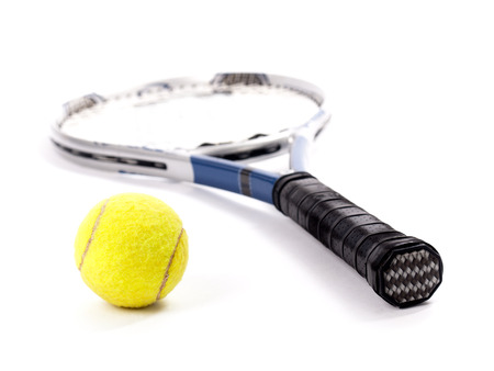 tennis racket: Studio shot of a yellow tennis ball and racket isolated on a white background