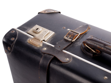 carryall: Detail of an old black vintage leather suitcase with straps and locks on a white background