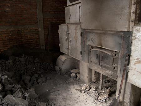 coal fired: An old fashioned coal fired oven in Darjeeling, India which is used to dry the tea leaves