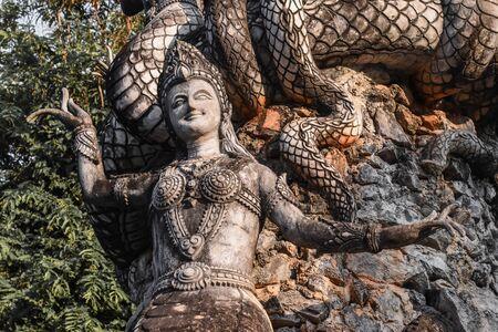 half Woman and snake statue name as Nakee at Sala Kaew ku(sculpture park) in Nong Khai Province Thailand