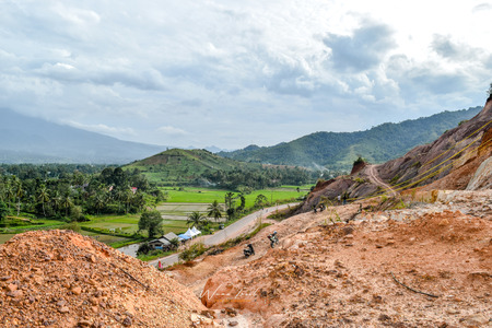 Expance of rice fields in the foothill Payakumbuh Stock Photo