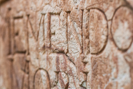 religious engraved letters on stone wall
