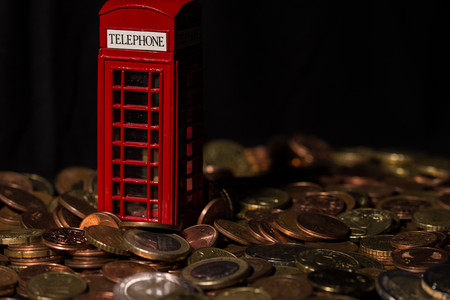 brexit concept - telephone kiosk and coins Stock fotó