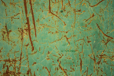 rusty scratches on green painted steel texture