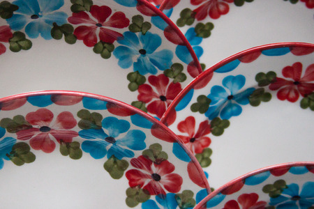 Beautiful colorful dishes patten. Traditional Latin American tableware. Hand painted flowered pattern. Stock fotó