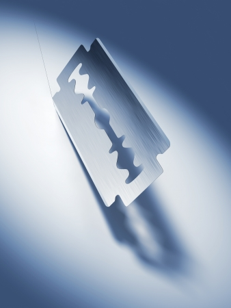 Old fashioned razor blade cutting - Sharp and dangerous! Stock Photo