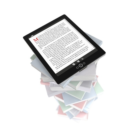 Tablet PC on stack of books Stock Photo