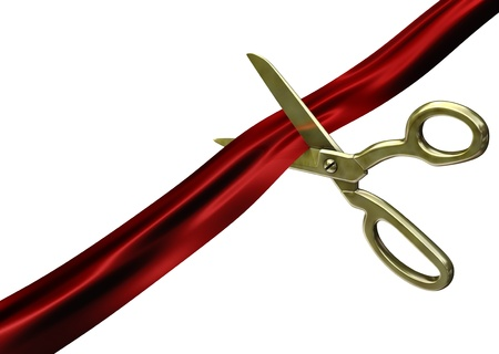 silk ribbon: Isolated scissors cutting red ribbon on white background
