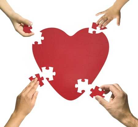 Heart puzzle. Family together-Happy family concept. Stock Photo - 9827480