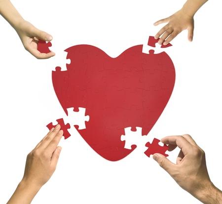 forme: Puzzle c?ur. Concept de la famille de la famille ensemble, heureux. Banque d'images
