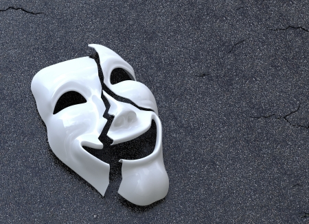 drama masks: Cracked Mask on asphalt surface  Concept image Stock Photo