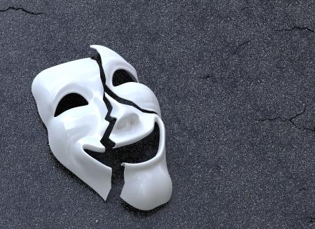 Cracked Mask on asphalt surface  Concept image Archivio Fotografico