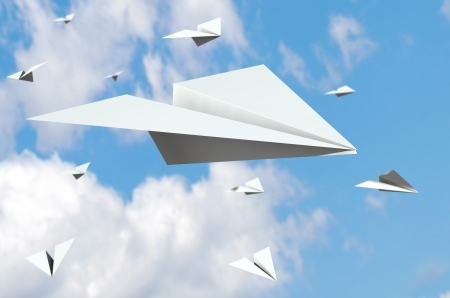 Paper Planes flying in the sky photo